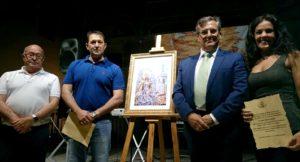 El Primer Teniente de Alcalde junto al Hermano Mayor de la Hermandad el premiado y una de las Menciones Especiales